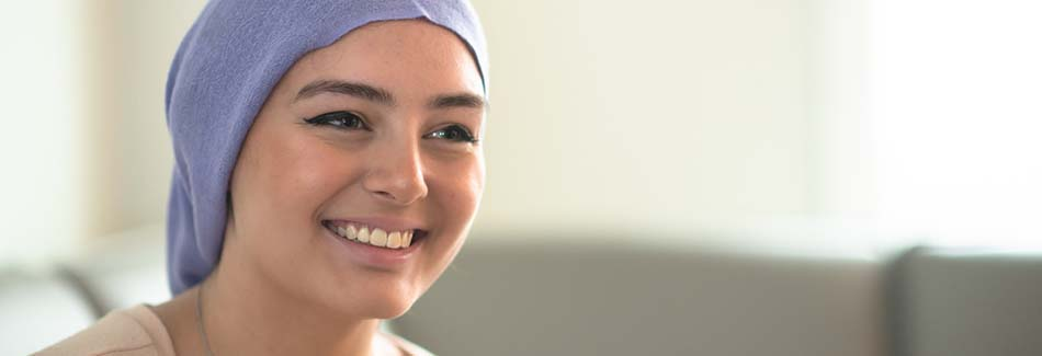 A young woman smiles at Baptist's cancer treatment center in North Mississippi