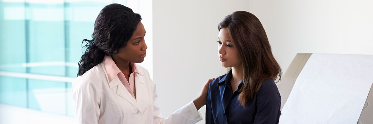 Female physician consults female patient